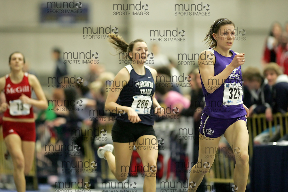 (Windsor, Ontario---11 March 2010) Jen Cotten of University of Western Ontario Mustangs competes in the  competes in the pentathlon 800m at the 2010 Canadian Interuniversity Sport Track and Field Championships at the St. Denis Center. Photograph copyright Sean Burges/Mundo Sport Images. www.mundosportimages.com