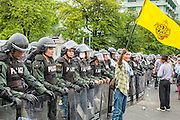 24 NOVEMBER 2012 - BANGKOK, THAILAND:  Pro monarchy protesters in front of Thai riot police during a large anti government, pro-monarchy, protest  on November 24, 2012 in Bangkok, Thailand. The Siam Pitak group, which sponsored the protest, cited alleged government corruption and anti-monarchist elements within the ruling party as grounds for the protest. Police used tear gas and baton charges againt protesters.       PHOTO BY JACK KURTZ