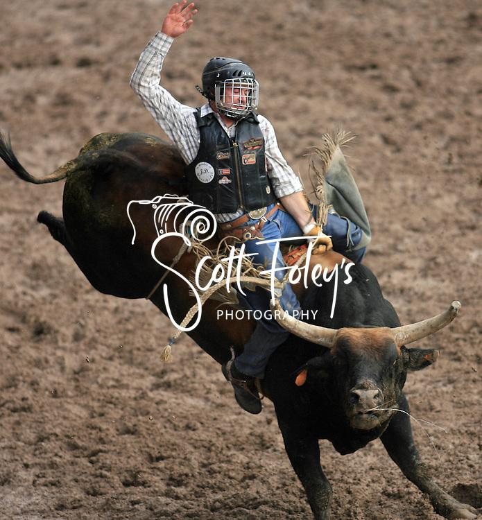 Bull Rider Charles Russel Zoss earns a 90 point ride on 096 David Johansen JO,  Championship Sunday, 29 July 2007, Cheyenne Frontier Days