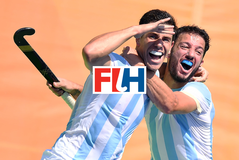 Argentina's Joaquin Menini (L) celebrates a goal with Argentina's Manuel Brunet during the men's semifinal field hockey Argentina vs Germany match of the Rio 2016 Olympics Games at the Olympic Hockey Centre in Rio de Janeiro on August 16, 2016. / AFP / MANAN VATSYAYANA        (Photo credit should read MANAN VATSYAYANA/AFP/Getty Images)