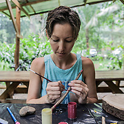 Erica Andrews, 40 years old, the other founder, together with Matthew Hogan, of Finca Bellavista, more than 10 years ago. Here photographed while doing some art activities on a rainy day at Finca