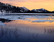 Sunset reflections, spring thaw, Tenaya Lake, Yosemite National Park, California