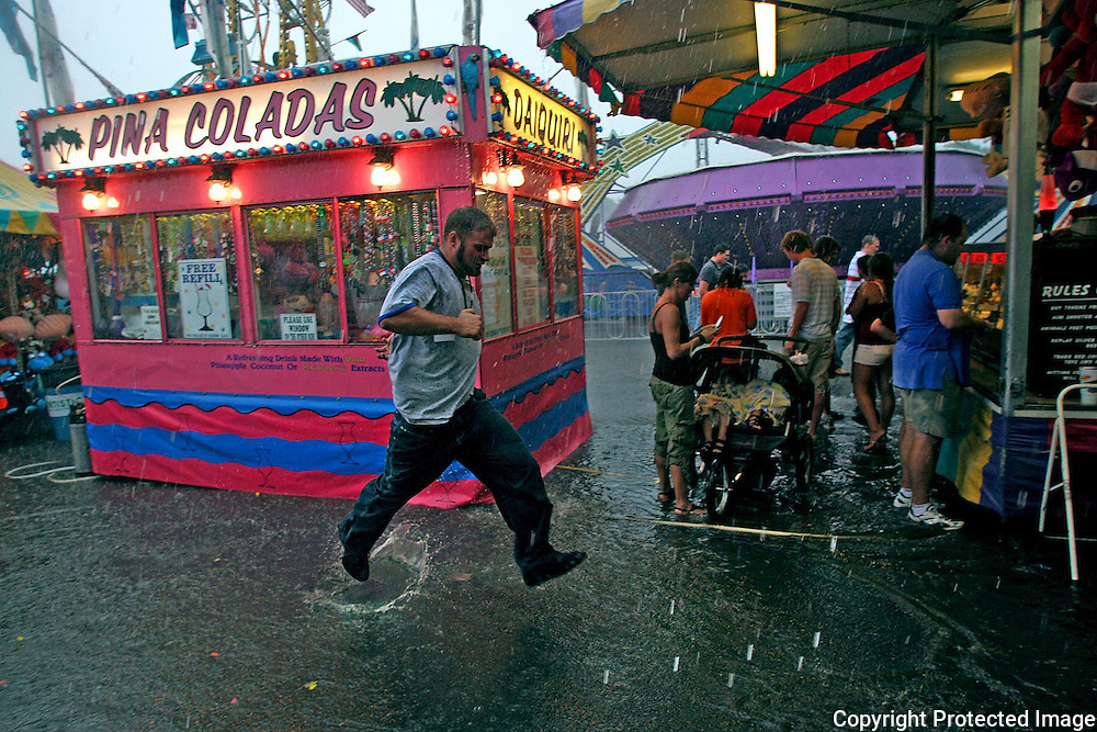 Sunday's fairgoers experienced a deluge at about 3pm.  Most of the Midway became flooded with about a foot of water.   DAVID PETERSON/REGISTER PHOTODes Moines, Ia.