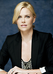 November 10, 2009 - Hollywood, California, U.S. - CHARLIZE THERON promotes 'The Road.' Charlize Theron (born August 7, 1975) is a South African-American actress and film producer. She has starred in several Hollywood films, such as The Devil's Advocate (1997), Mighty Joe Young (1998), The Cider House Rules (1999), Monster (2003), The Italian Job (2003), Hancock (2008), A Million Ways to Die in the West (2014), Mad Max: Fury Road (2015) and The Fate of the Furious (2017). (Credit Image: © Armando Gallo via ZUMA Studio)