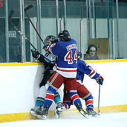 Lindsay, ON - Jan 31 : Ontario Junior Hockey League game action between the Lindsay Muskies and the North York Rangers. Kyle Thacker #44 of the North York Rangers Hockey Club makes the hit on Vince Herlihey #9 of the Lindsay Muskies Hockey Club, during second period game action.<br /> (Photo by Tim Bates / OJHL Images)