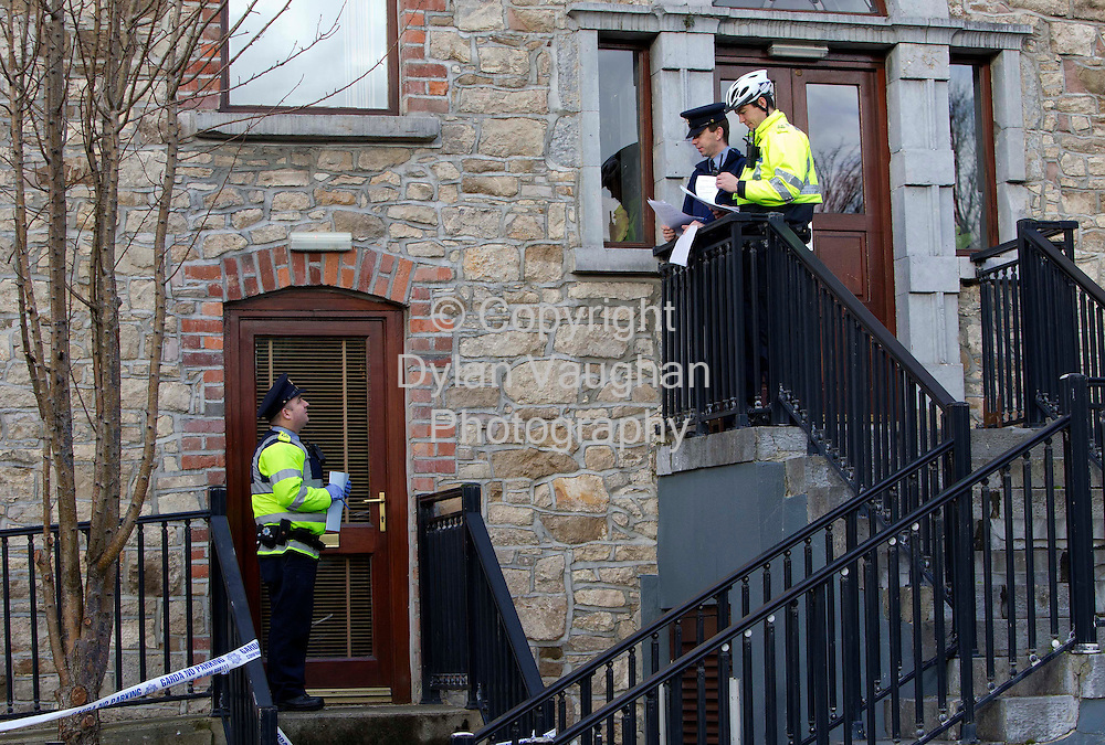 18/1/2012.Gardai pictured making house to house inquiries near  the scene where a mans body was found on in the foyer of an apartment block on New Quay in Clonmel Co. Tipperary..Picture Dylan Vaughan...