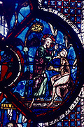 God creating Adam. Chatres Cathedral stained glass window of the Good Samaritan. 13th century.