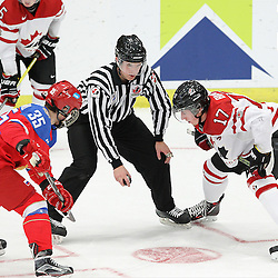 COBOURG, - Dec 19, 2015 -  Gold Metal Game - Russia vs Canada West at the 2015 World Junior A Challenge at the Cobourg Community Centre, ON. Face-off between Viacheslav Shevchenko #35 of Team Russia and Tyler Busch #17 of Team Canada West. IIHF Linesman Justin Knaggs. (Photo: Tim Bates / OJHL Images)