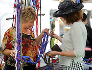 kathy Glenn of Telford, Pennsylvania shows off one of her Conneckapup leashes to Mel Lowe of Upper Black Eddy, Pennsylvania during the Tinicum Arts Festival which featured about 100 vendors and 180 artists and crafts people Saturday July 11, 2015 in Tinicum, Pennsylvania. (Photo by William Thomas Cain)