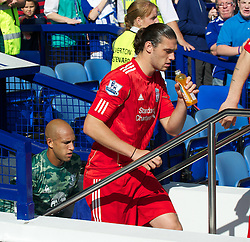 LIVERPOOL, ENGLAND - Saturday, October 1, 2011: Liverpool's Andy Carroll walks out to face Everton during the Premiership match at Goodison Park. (Pic by David Rawcliffe/Propaganda)