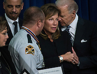 WASHINGTON, DC - February 20:  Attorney General Eric Holder and Vice President Joseph Biden comfort Paige Baitlinger, widow of fallen Sergeant Thomas Baitlinger, during a Medal of Valor ceremony at the White House Wednesday, February 20, 2013. The Medal of Valor is awarded to public safety officers who have exhibited exceptional courage, regardless of personal safety, in the attempt to save or protect others from harm. (Photo by Melina Mara/The Washington Post)