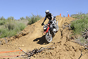 Bill Dragoo of Norman, OK descending steep slope during day 1 competition at 2010 Rawhyde Adventure Rider Challenge