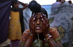 Radha Bhamwari, 15, bathes before her wedding begins in Rajasthan, India on April 27, 2009.