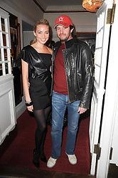 NOELLE RENO and SCOT YOUNG at an In-House screening of 'Sweet Smell of Success' hosted by Clive Owen presented by Tod's in association with Amend held at The Electric Cinema, 191 Portobello Road, London W11 on 29th November 2010.