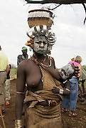 Africa, Ethiopia, Debub Omo Zone, woman of the Mursi tribe. A nomadic cattle herder ethnic group located in Southern Ethiopia, close to the Sudanese border. Woman with clay lip disc as body ornaments
