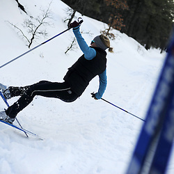 A skier falls while a attempting a manuever.