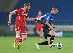Cardiff City's Aron Gunnarsson pulls on the shirt of Bournemouth's Shaun MacDonald - Photo mandatory by-line: Dougie Allward/JMP - Mobile: 07966 386802 - 23/09/2014 - SPORT - FOOTBALL - Cardiff - Cardiff City Arena - Cardiff City v AFC Bournemouth - Capital One Cup - Third Round