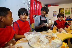 © Licensed to London News Pictures. 03/11/2014. LONDON, UK. Lorraine Pascale participates in a bread making lesson at Weston Park Primary School in Crouch End, London on Monday 3 November 2014. Photo credit : Tolga Akmen/LNP