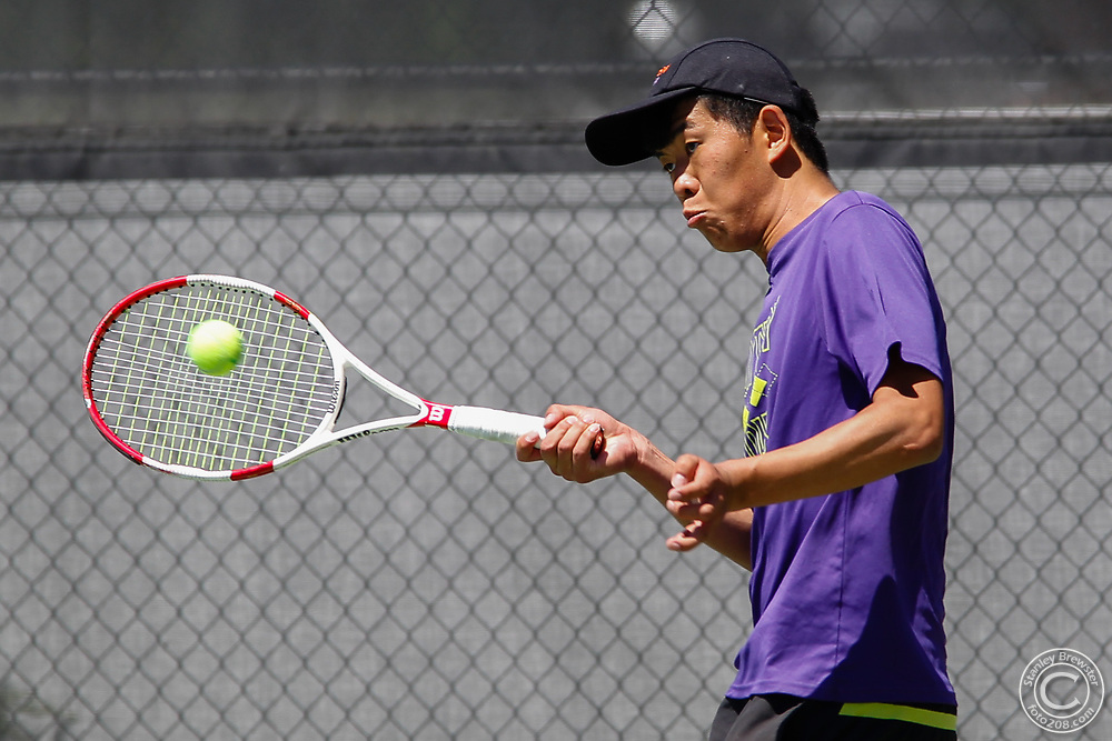 Century's Brian Zhu competes in the consolation match at the Idaho State Boys 4A Tennis Championships