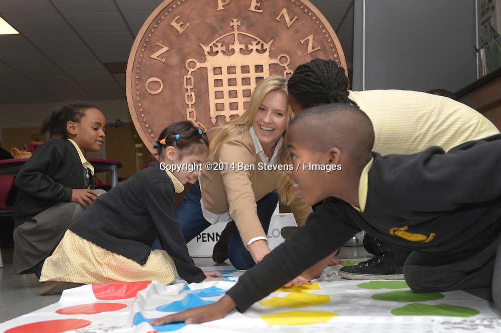Image &copy;Licensed to i-Images Picture Agency. 18/12/2014. London, United Kingdom. <br /> <br /> Penny Lancaster visits Charlton Manor Primary School where the Mayors Fund initiative 'Penny for London' is raising money to fund breakfasts for school children.<br /> <br /> Penny Lancaster plays Twister with children at breakfast club.<br /> <br /> Picture by Ben Stevens / i-Images