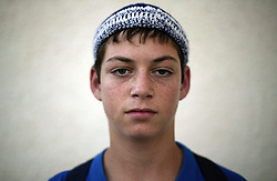 "Yona Tal, 13, a student and resident of the Gush Katif settlements, is seen in Gaza, Palestinian Territories, Nov. 4, 2004. When asked his thoughts about being forced to leave the settlements, he responded like a boy wise beyond his years, ""This is our hope and we cannot lose it. We will hold the Likud responsible and raise our voices against this decision."" Israel's parliament recently supported compensation payments for Jewish settlers leaving the Gaza Strip, in a vital vote for Prime Minister Ariel Sharon's plan to evacuate the occupied territory."