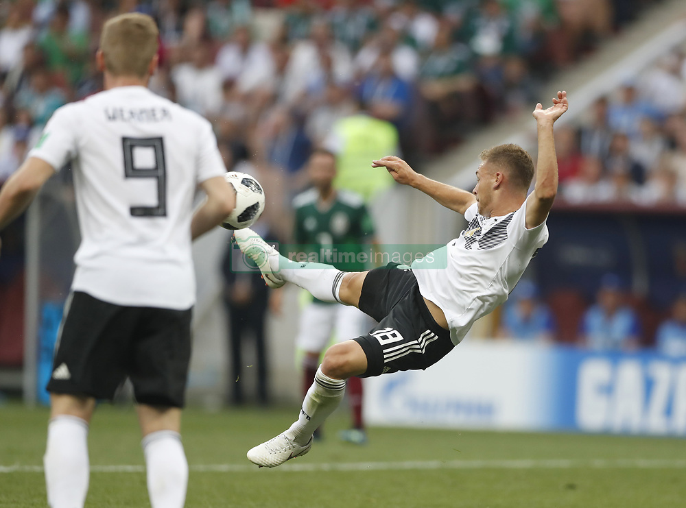 MOSCOW, June 17, 2018  Joshua Kimmich (R) of Germany shoots with an overhead kick during a group F match between Germany and Mexico at the 2018 FIFA World Cup in Moscow, Russia, June 17, 2018. (Credit Image: © Cao Can/Xinhua via ZUMA Wire)