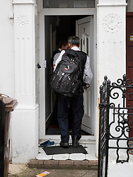 © Licensed to London News Pictures. 19/07/2019. London, UK. Police enter a house where it is reported that the body of a woman was found on fire in the back garden of a property in Chadwell Heath, East London. Fire fighters arrived at the house and then called in the police when they found the woman. Photo credit: Peter Macdiarmid/LNP