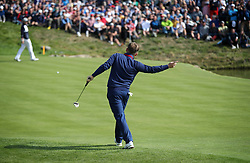 Team Europe's Tyrrell Hatton wills his ball on the 16th during the Fourballs match on day one of the Ryder Cup at Le Golf National, Saint-Quentin-en-Yvelines, Paris.