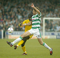 Fotball<br /> Photo. Andrew Unwin, Digitalsport<br /> NORWAY ONLY<br /> <br /> Yeovil v Cheltenham, Nationwide League Division Three, Huish Park, Yeovil 10/04/2004.<br /> Cheltenham's Damian Spencer (l) is tackled by Yeovil's Hugo Rodrigues (r).