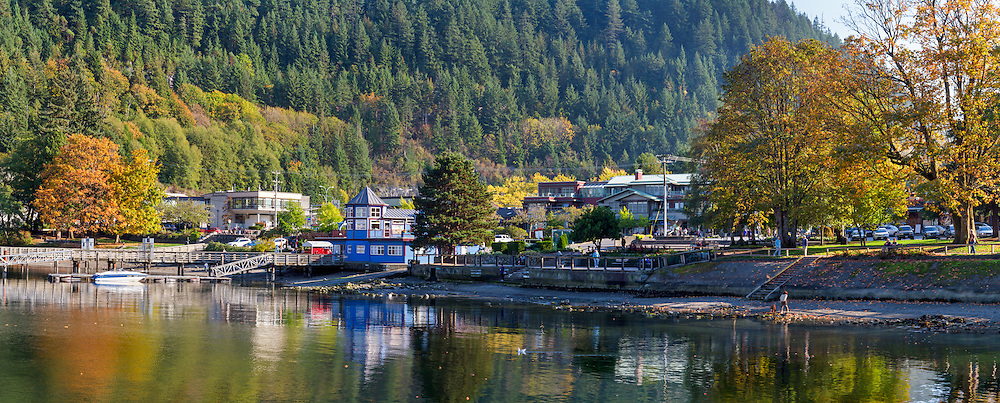 The shoreline at Horseshoe Bay, British Columbia, Canada.  Photographed from the Horseshoe Bay Public Dock.  Horseshoe Bay Park is on the right and the blue building to the left is the Lookout Coffee Shop at Sewell's Marina.