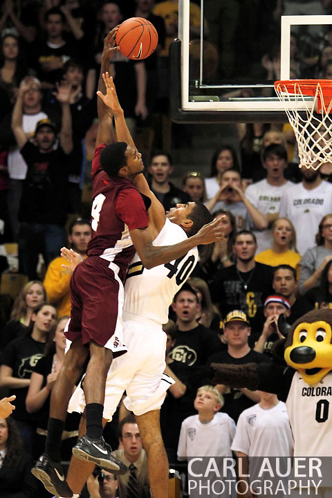 November 27, 2012: Texas Southern Tigers senior forward Fred Sturdivant (4) attempts a monster dunk over Colorado Buffaloes freshman forward Josh Scott (40) in the NCAA Basketball game between the Texas Southern Tigers and the Colorado Buffaloes at the Coors Event Center in Boulder Colorado