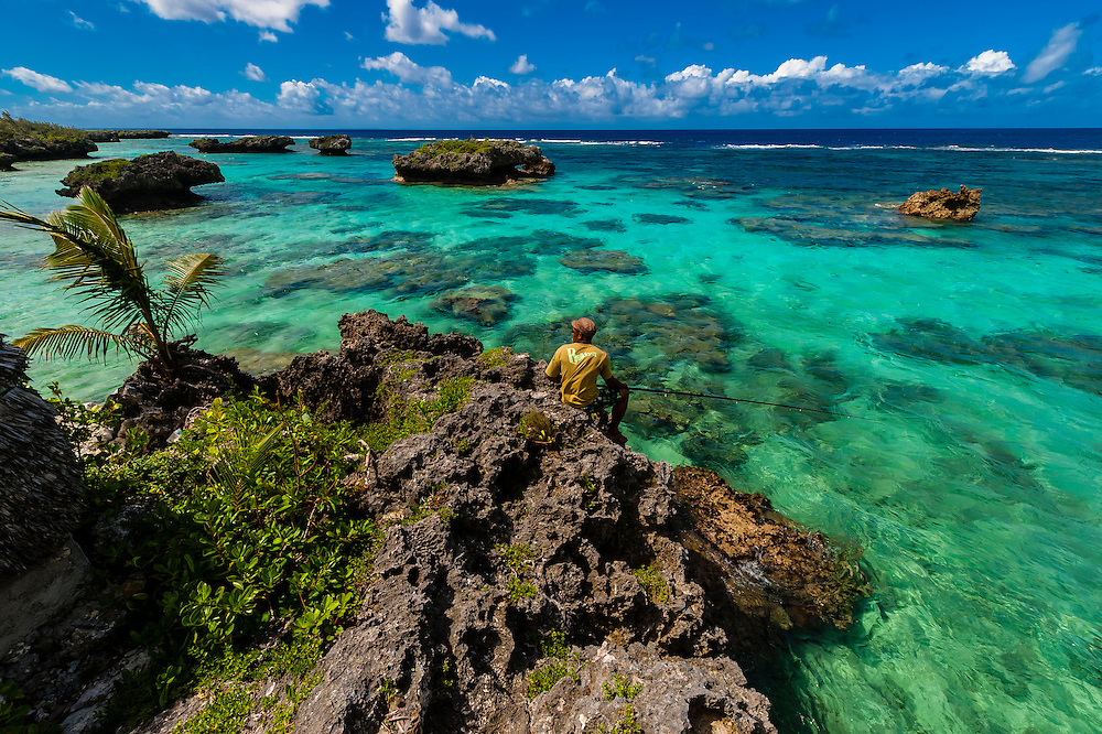 Man fishing on the Coral reef, Roh Seday Home Stay, North Bay, island of Mare, Loyalty Islands, New Caledonia