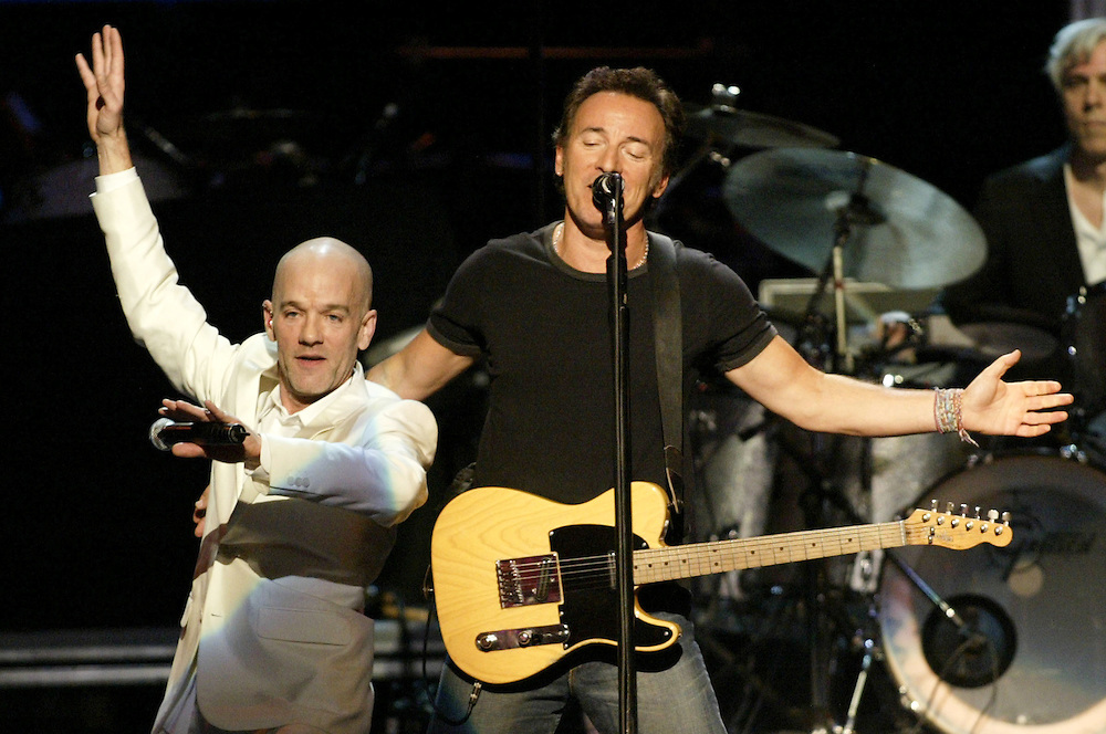 Bruce Springsteen performs with Michael Stipe and R.E.M. at the MCI center in Washington, DC during the Vote For Change concert on Monday, Oct. 11, 2004. (Matthew Cavanaugh - For The New York Times)
