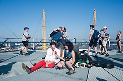 Musician Robbie Boyd plays on top of the O2 Arena.<br /> Up and coming musician Robbie Boyd, who won the Mayor's Gigs Big Busk competition in 2011 being interviewed after playing at the top of the O2 Arena,<br /> London, United Kingdom<br /> Thursday, 18th July 2013<br /> Picture by Piero Cruciatti / i-Images