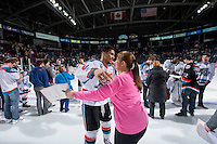 KELOWNA, CANADA - MARCH 21: Tyrell Goulbourne #12 of Kelowna Rockets congratulates the winner of his third jersey on March 21, 2015 at Prospera Place in Kelowna, British Columbia, Canada.  (Photo by Marissa Baecker/Shoot the Breeze)  *** Local Caption *** Tyrell Goulbourne;