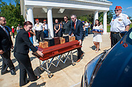 Amanda Cape (left) of Fluehr Funeral Home and Rep Brian Fitzpatrick bring the remains of 12 veterans to a hearse for transportation to their final resting place after burial services with full military honors, held for 12 veterans left unattended by family or friends Thursday, August 29, 2019 at Washington Crossing National Cemetery in Washington Crossing, Pennsylvania. Once a month, burials are held for veterans who have no family and their remains have never been claimed. Some vets remains have waited 12 years for burial. (Photo by William Thomas Cain / CAIN IMAGES)