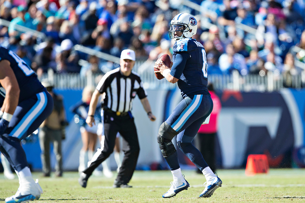 NASHVILLE, TN - OCTOBER 18:  Marcus Mariota #8 of the Tennessee Titans looks downfield for a receiver during a game against the Miami Dolphins at LP Field on October 18, 2015 in Nashville, Tennessee.  The Dolphins defeated the Titans 38-10.  (Photo by Wesley Hitt/Getty Images) *** Local Caption *** Marcus Mariota