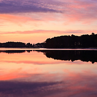 Sunrise reflected in the waters of the Little Blackwater River, Blackwater National Wildlife Refuge, Cambridge, Maryland.