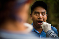 An IFIFT student under the supervision of FAFG staff collects a cheek swab from a local Ixil man. The sample will allow the DNA lab to further document the relationships between surviviors and victims.