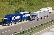 Europe, Germany, Rhineland-Palatinate, trucks at a climb of the Autobahn A3 near Neustadt Wied.....Europa, Deutschland, Rheinland-Pfalz, LKW an einer Steigung der Autobahn A3 bei Neustadt Wied...