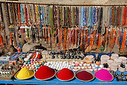 Colored powders and jewelry, Hampi, India.