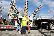 Workers prepare to move one of the four new transformers at the Robert Moses-Robert H. Saunders Dam in Massena on Wednesday, November 12, 2014.