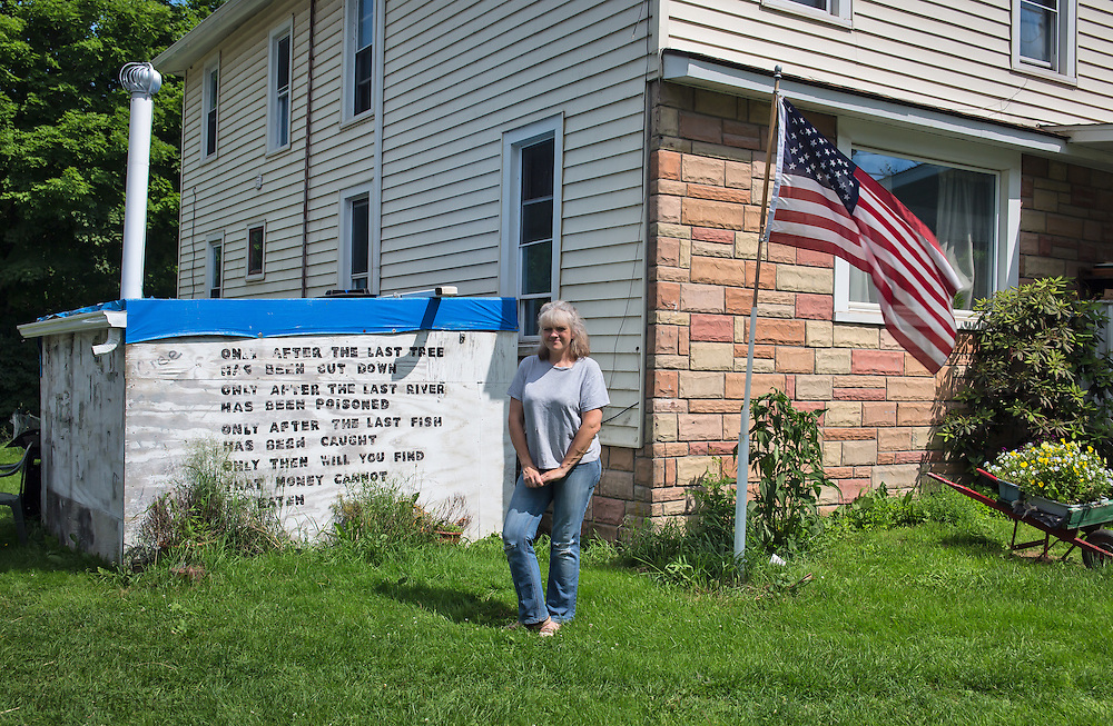 Tammy Manning in front of her home in Franklin Forks PA. Her  water was contaminated after fracking began near her home . Vera Scroggins brings people on tours through Susquehanna County to meet with her so she can tell her story.