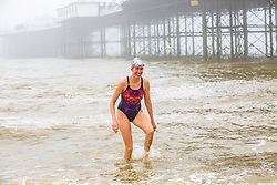 © Licensed to London News Pictures. 02/06/2018. Brighton, UK. Members of the Brighton Swimming Club take part in their daily swim as the Brighton Palace Pier is covered in a thick coat of sea mist. Photo credit: Hugo Michiels/LNP