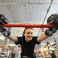 011310: Falcone: Cassandra Falcone , 23 of Manchester NH trains at West End Gym in lowell for upcoming Golden Gloves Boxing tournament .