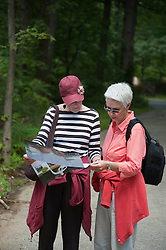 Women Reading  a map while out in a park