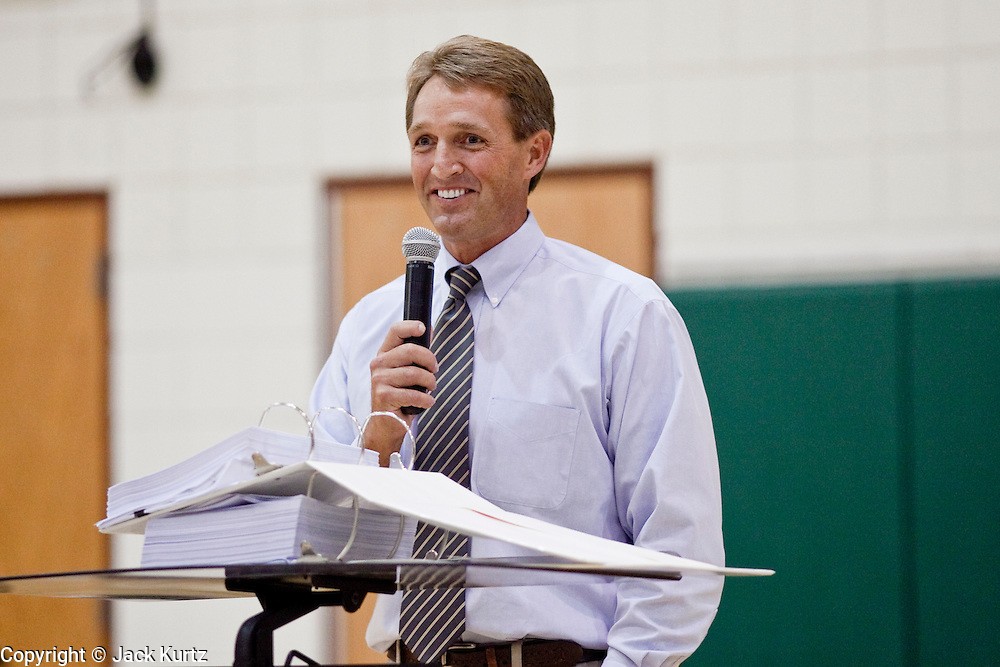 "Aug 10, 2009 -- CHANDLER, AZ: Congressman JEFF FLAKE speaks from a podium with a copy of the health care reform bill in front of him. Rep. Flake, (R-AZ) hosted a ""town hall"" style meeting on health care reform at Basha High School in Chandler Monday. Flake, a conservative Republican, has opposed President Obama on many issues, like the stimulus and health care reform. Protestors who have shut down similar meetings hosted by Democrats, gave Flake a warm welome. About 1,600 people attended the meeting.   Photo by Jack Kurtz"