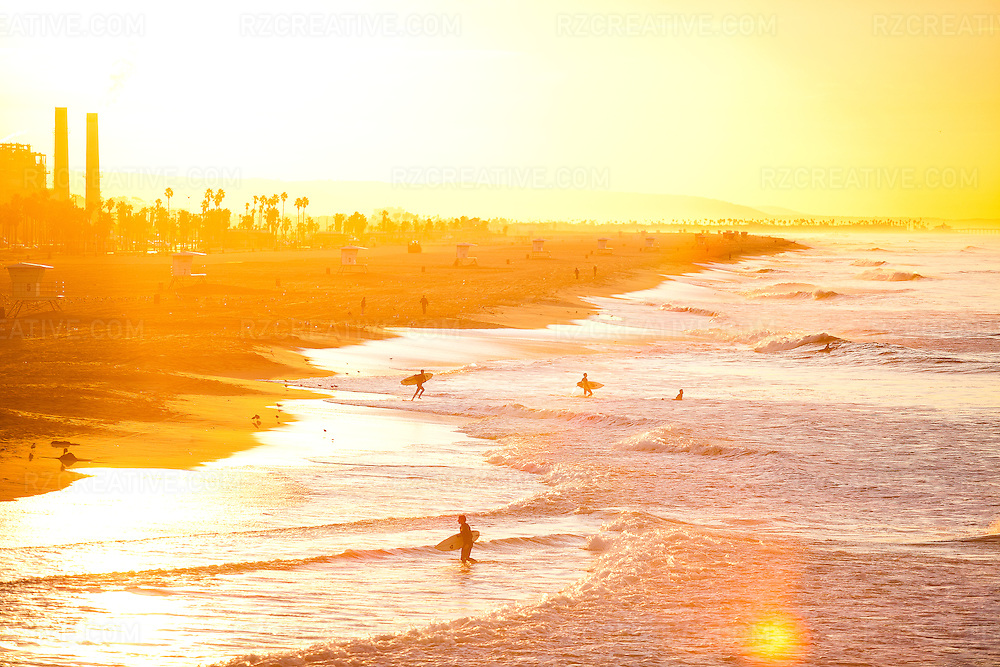 Surfers at sunrise in Huntington Beach, California. Photo by Robert Zaleski/rzcreative.com