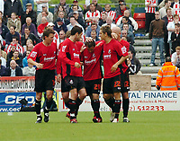 Photo: Kevin Poolman.<br />AFC Bournemouth v Brentford. Coca Cola League 1. 06/05/2006. Bournemouth players celebrate with Steven Foley after his free kick.