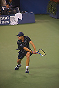 Flushing Meadows, Queens, New York, August 31 2009: Andy Roddick  (USA)  lunges for a two-handed backhand return in his opening match against Bjorn Phau (GER) at the US OPEN at Arthur Ashe Stadium, The USTA Billie Jean King National Tennis Center, Queens, New York, United States. Roddick won that match 6-1, 6-4, 6-2. Close up shot. EDITORIAL USE ONLY